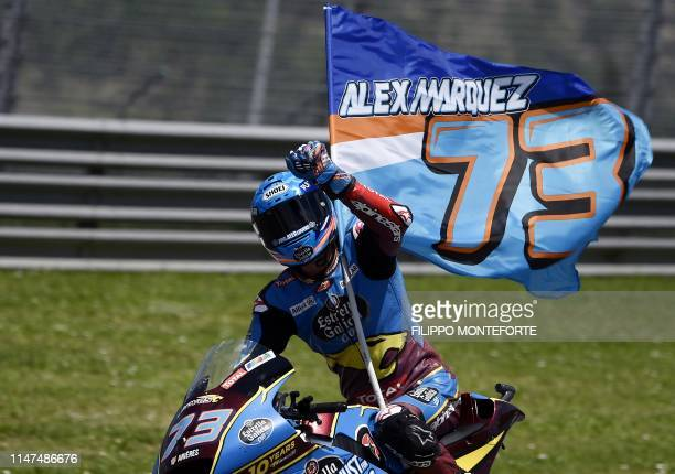 Spain's Alex Marquez celebrates after winning the Italian Moto2 category Grand Prix at the Mugello race track on June 2 2019 in Scarperia e San Piero