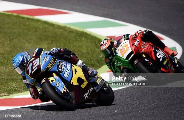 Spain's Alex Marquez rides his Kalex ahead of fellow Italian rider Luca Marini riding his Kalex, on his way to win the Italian Moto2 category Grand...