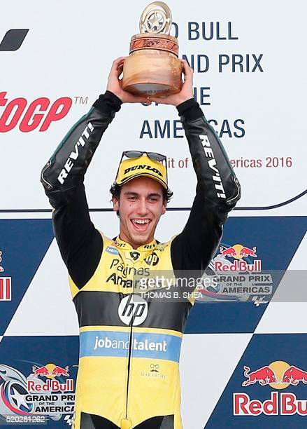 Spain's Alex Rins celebrates winning the 2016 Grand Prix of the Americas Moto2 race at circuit of the Americas in Austin Texas on April 10 2016 / AFP...