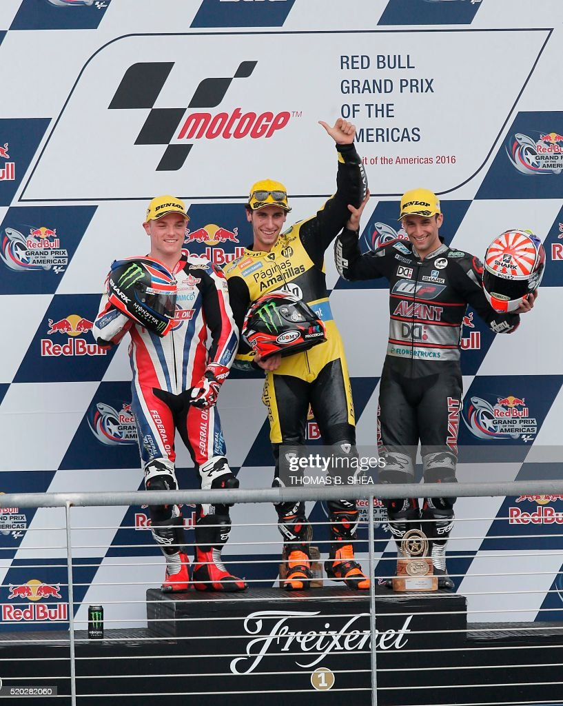 Spain's Alex Rins (C), Great Britain's Sam Lowes (L ), and France's Johann Zarco (R) celebrate on the podium after the 2016 Grand Prix of the Americas Moto2 race at circuit of the Americas, in Austin, Texas on April 10, 2016. / AFP / Thomas B. Shea