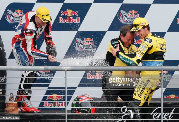 Spain's Alex Rins is sprayed with champagne by Great Britain's Sam Lowes after Rins won the the 2016 Grand Prix of the Americas Moto2 race at circuit...