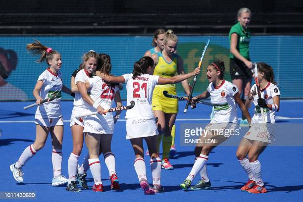 Spain's Alicia Magaz celebrates with teammates after scoring a goal during the bronze medal field hockey match between Australia and Spain of the...