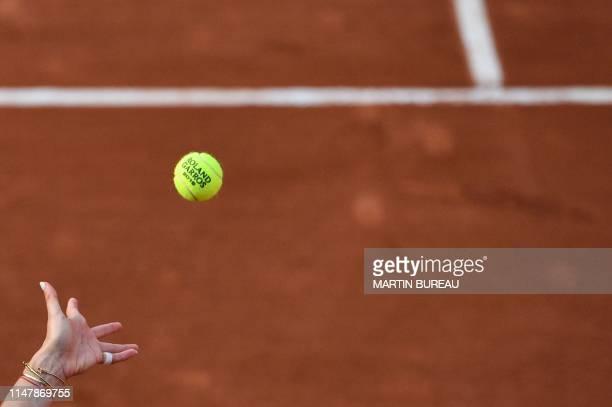Spain's Aliona Bolsova serves a 2019 French Open tennis tournament official ball to Amanda Anisimova of the US during their women's singles fourth...