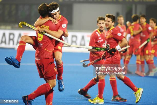 Spain's Alvaro Iglesias with teammate Enrique Gonzalez celebrate after scoring a goal against France during the field hockey group stage match...
