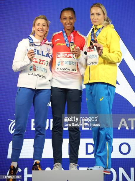 Spain's Ana Pelteiro poses with her gold medal after winning the Women's Triple Jump alongside second placed Greece's Paraskevi Papachristou and...