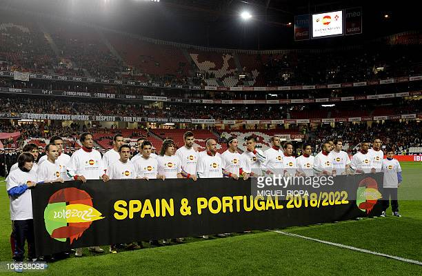 Spain´s and Portugal´s teams hold a banner promoting the Iberian bid for the 2018 world cup before their friendly football match at the Luz Stadium...