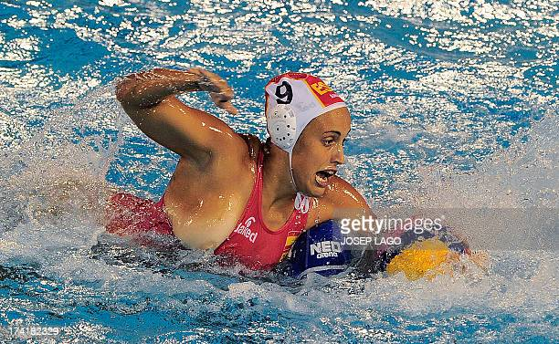 Spain's Andrea Blas vies with Netherlands' Leike Klaassen during their preliminary round match of the women's water polo competition at the FINA...