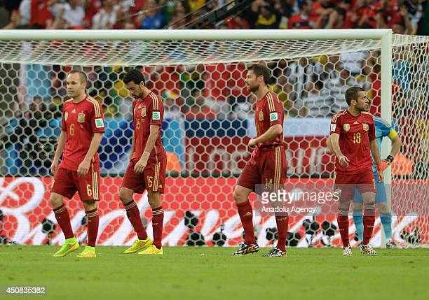 Spain's Andres Iniesta Alonso Sergio and Jordi Alba react after the 2014 FIFA World Cup Brazil Group B match between Spain and Chile at Estadio...