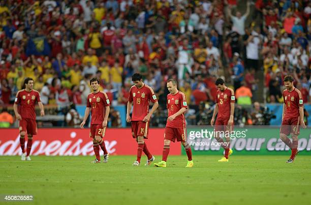 Spain's Andres Iniesta David Silva and Diego Costa react after a goal during the 2014 FIFA World Cup Group B soccer match between Spain and Chile at...