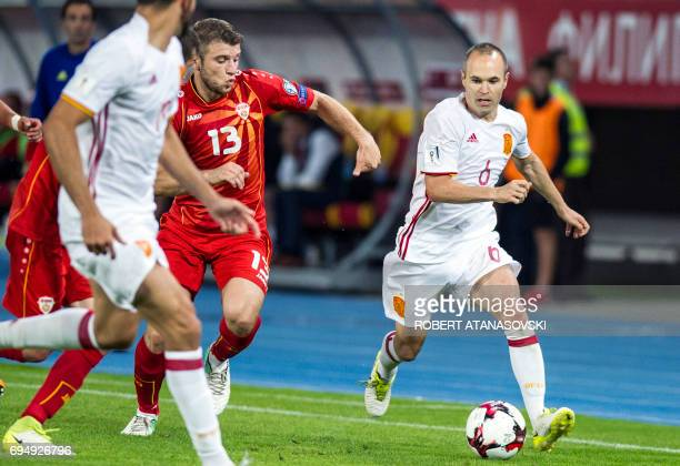 Spain's Andres Iniesta vies with Macedonia's Stefan Ristovski during the FIFA World Cup 2018 qualification football match between Macedonia and Spain...