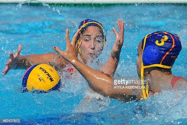Spain's Anna Espar Llaquet and her teammate Maria del Pilar Pena fight for the ball with Italy's Aleksandra Cotti during the women's Water Polo...