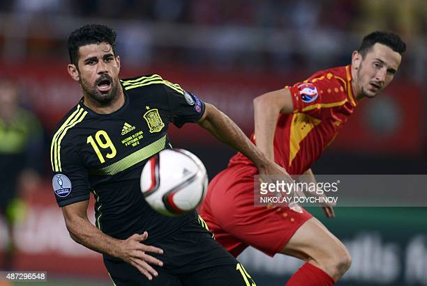 Spain's Argentinianborn forward Diego Costa vies with Macedonia's Defender Kire Ristevski during the Euro 2016 Group C qualifying football match...