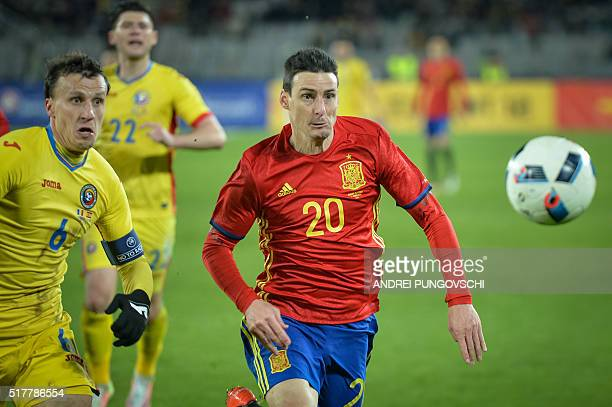 Spains Aritz Aduriz and Romanias Vlad Iulian Chiriches ie for the ball during the friendly football match between Romania and Spain in Cluj Napoca...