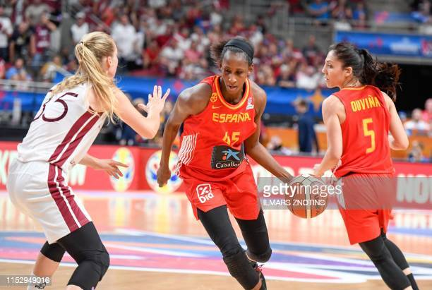 Spain's Astou Ndour and Latvia's Kate Kreslina vie for the ball during Women's Eurobasket 2019 Basketball match in Riga, Latvia, on June 30, 2019.
