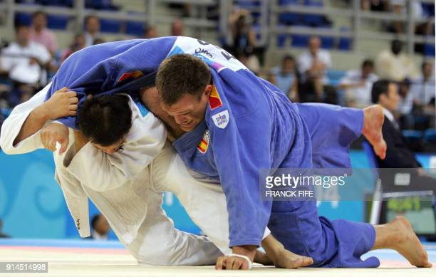 Spain's Aytami Ruano fights against Korea's Sung Beom Kim during the men's 100 kg judo competition 20 August 2004 at the Ana Liosia Olympic Hall in...