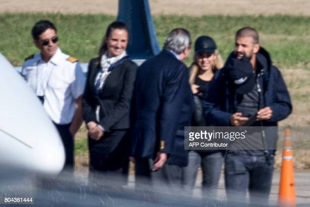Spain's Barcelona footballer Gerard Pique and his wife Colombian singer Shakira arrive at Rosario's airport Santa Fe Province Argentina on June 30...