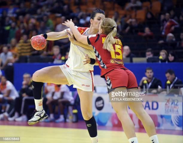 Spain's Beatrix Fernandez fights for the ball with Montenegro's Andrea Klikovac during the 2012 EHF European Women's Handball C hampionship Group II...