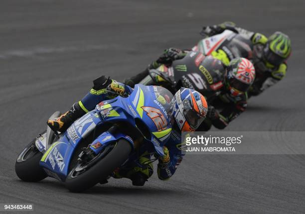 Spain's biker Alex Rins rides his Suzuki to finish in third place in the MotoGP race of the Argentina Grand Prix at Termas de Rio Hondo circuit in...