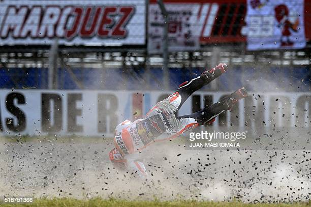 TOPSHOT Spain's biker Marc Marquez flies after falling from his Honda during the MotoGP qualifying session of the Argentina Grand Prix at Termas de...