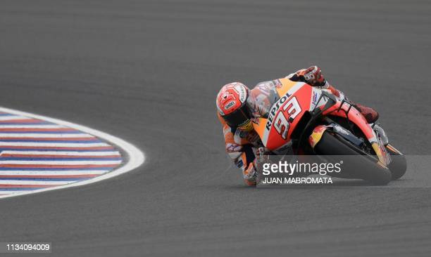 TOPSHOT Spain's biker Marc Marquez rides his Honda during the warmup of the MotoGP of the Argentina Grand Prix at the Termas de Rio Hondo circuit in...