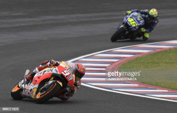 Spain's biker Marc Marquez rides his Honda to get the pole position ahead of Italy's biker Valentino Rossi riding his Yamaha to get the 7th grid...