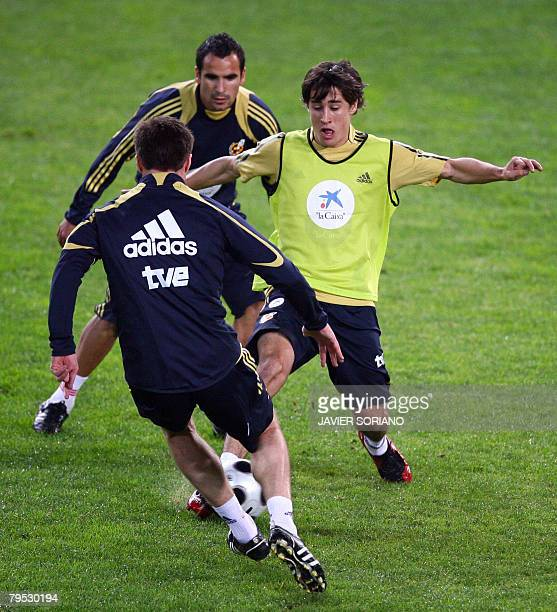 Spain's Bojan Krikic Xavi Alonso and Fernando Navarro take part in a training session on February 5 2008 on the eve of their football friendly match...