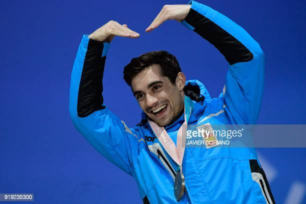TOPSHOT Spain's bronze medallist Javier Fernandez poses on the podium during the medal ceremony for the figure skating Men's singles event at the...