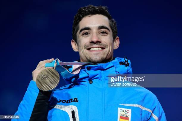 Spain's bronze medallist Javier Fernandez poses on the podium during the medal ceremony for the figure skating Men's singles event at the Pyeongchang...