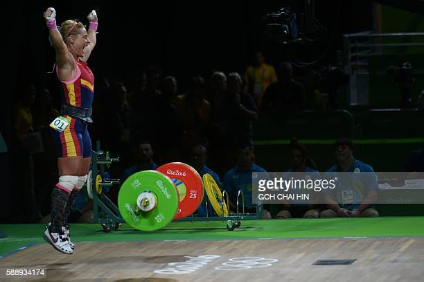 Spain's bronze medallist Lidia Valentin Perez celebrates during the women's weightlifting 75kg event during the Rio 2016 Olympics Games in Rio de...