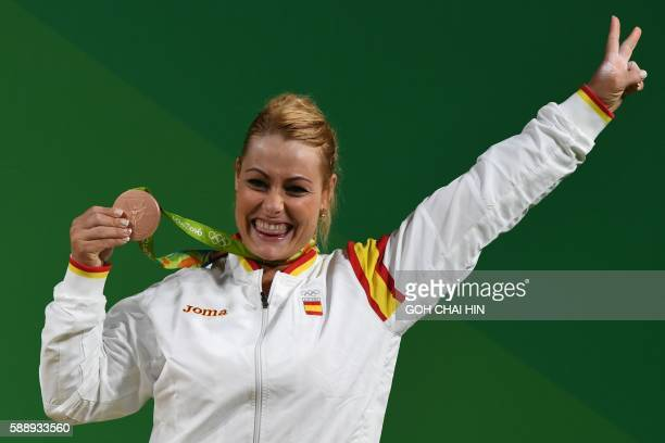 Spain's bronze medallist Lidia Valentin Perez poses on the podium after the women's weightlifting 75kg event during the Rio 2016 Olympics Games in...