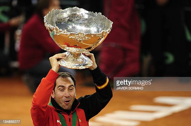Spain's captain Albert Costa celebrates holding the David Cup trophy after winning the Davis Cup final against Argentina at La Cartuja Olympic...