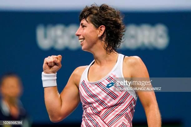 Spain's Carla Suarez Navarro celebrates winning the first set against Russia's Maria Sharapova during their 2018 US Open Women's Singles tennis match...