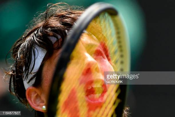 Spain's Carla Suarez Navarro returns against US player Serena Williams during their women's singles fourth round match on the seventh day of the 2019...