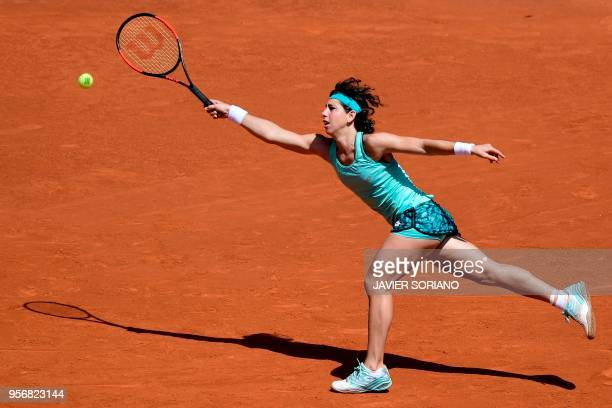 Spain's Carla Suarez Navarro returns the ball to France's Caroline Garcia during their WTA Madrid Open quarterfinal tennis match at the Caja Magica...