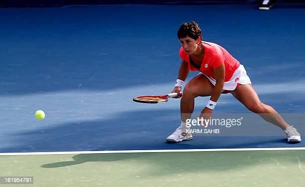 Spain's Carla Suarez Navarro returns to Daniela Hantuchova of Slovakia during the WTA Dubai Open tennis Championship in the Gulf emirate on February...