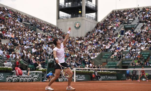 Spain's Carla Suarez Navarro serves to Canada's Eugenie Bouchard during their French tennis Open quarter final match at the Roland Garros stadium in...