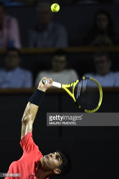 Spain's Carlos Alcaraz serves during the match against Argentina's Federico Coria during the ATP World Tour Rio Open 2020 tournament Jockey Club in...