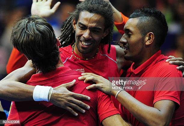 Spain's Carlos Moya of Singapore Slammers celebrates with his team members after defeating France's Fabrice Santoro of Indian Aces during their men's...