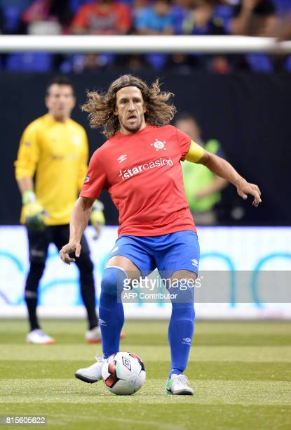 Spain's Carlos Puyol passes the ball during the Star Sixes semifinal football match between France and Spain at the O2 Arena in London on July 16 won...