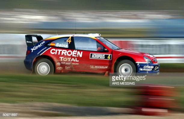 Spain's Carlos Sainz and his codriver Marc Marti with their Citroen Xsara compete during the Acropolis rally of Greece in the Lilea special stage 03...