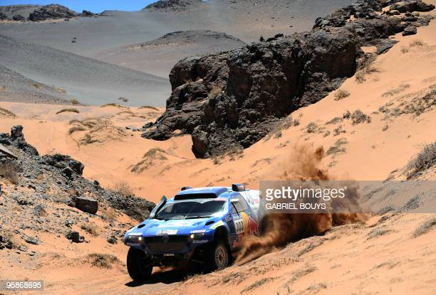 Spain's Carlos Sainz steers his Volkswagen during the 8th stage of the Dakar 2010 between Antofagasta and Copiapo Chile on January 10 2010 France's...