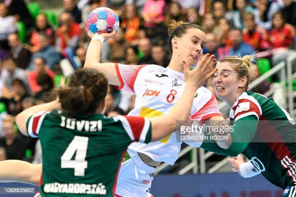 Spain's center back Silvia Arderus Martin shoots at the goal despite Hungary's right back Szimonetta Planeta during Women Euro 2018 handball...
