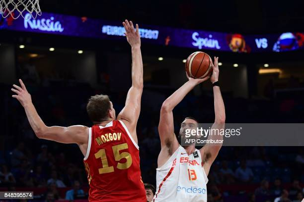 TOPSHOT Spain's center Marc Gasol tries to score next to Russia's center Timofey Mozgov during the FIBA Euro basket 2017 men's 3rd game match between...