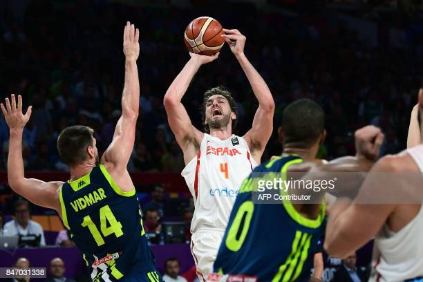 Spain's center Pau Gasol attempts to score next to Slovenia's center Luka Gasper and Anthony Randolph during the FIBA Eurobasket 2017 men's semifinal...