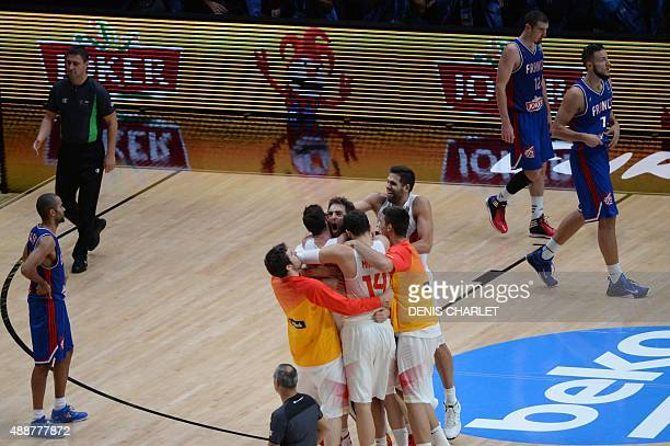 Spain's center Pau Gasol celebrates with his teammates as France's point guard Tony Parker looks on after Spain defeated France in the semifinal...