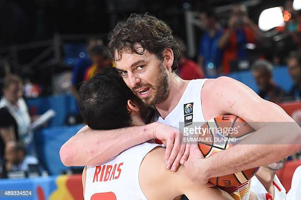 Spain's center Pau Gasol embraces Spain's point guard Pau Ribas as they celebrate after Spain won the final basketball match between Spain and...