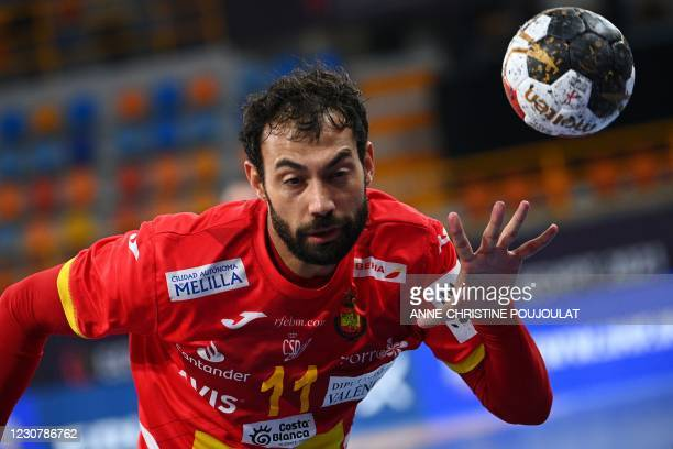 Spain's centre back Daniel Sarmiento passes the ball during the 2021 World Men's Handball Championship match between Group I teams Spain and Hungary...