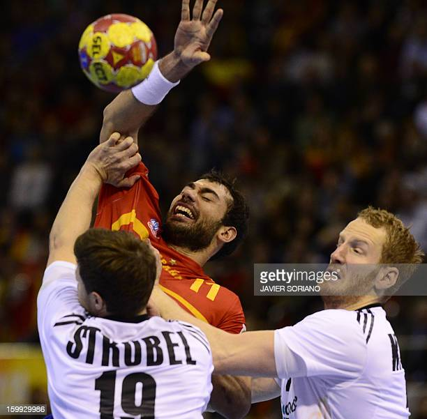 Spain's centre back Daniel Sarmiento vies with Germany's centre back Martin Strobel and Germany's right wing Steffen Weinhold during the 23rd Men's...