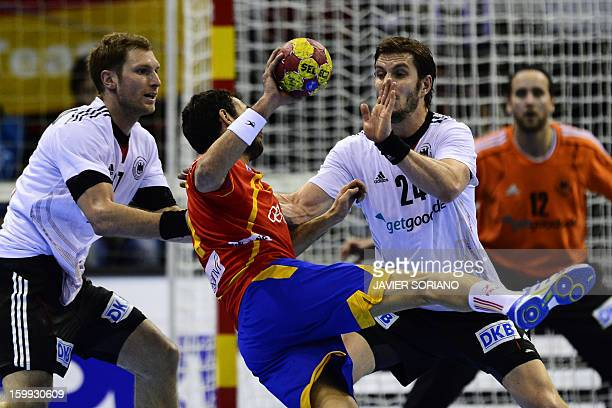 Spain's centre back Daniel Sarmiento vies with Germany's right wing Steffen Weinhold and Germany's centre back Michael Haas during the 23rd Men's...