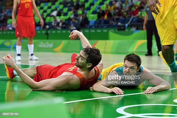 Spain's centre Pau Gasol and Australia's guard Matthew Dellavedova look on after falling during a Men's Bronze medal basketball match between...